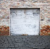 Roll up garage door on brick wall Stock Photo
