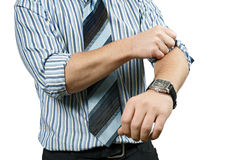 Roll up his sleeves. A business person, rolling up his sleeves and getting to work.  Metaphor for starting a business, or getting to work Royalty Free Stock Photo