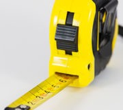 Roll-up tape measure on a white background Royalty Free Stock Image
