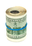 Roll of US dollar wrapped by rubber Stock Photo