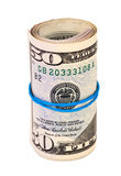 Roll of US dollar wrapped by rubber Royalty Free Stock Photo