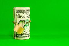 Roll of US dollars chained and locked Stock Photography
