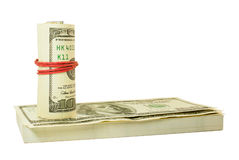 Roll of US dollars tied up with rubber Royalty Free Stock Image
