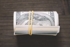 Roll of US one hundred dollar bills . Stock Photography