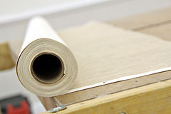 Roll of wallpaper on bench Royalty Free Stock Images