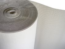 Roll of wave craft paper or brown corrugated cardboard of packaging for transportation. royalty free stock photography