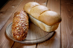 Roll and white loaf Royalty Free Stock Photography