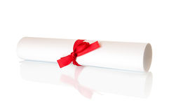 Roll white paper with red ribbon Royalty Free Stock Images