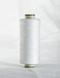Roll of white thread. Stock Photography