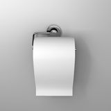 Roll of white toilet paper. Hanging on a chrome toilet roll holder on an isolated background Royalty Free Stock Image
