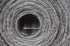 Roll of Wire Fencing. A silvery grey roll of wire fencing Stock Photography