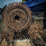 Roll of wire mesh at the construction site. Using for reinforcement of concrete grounding Stock Photos