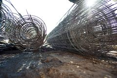 Roll of wire mesh at the construction site. Roll of wire mesh for reinforcement of concrete floor at the construction site Royalty Free Stock Photos