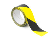 Caution tape. Roll of yellow and black caution tape stock photography