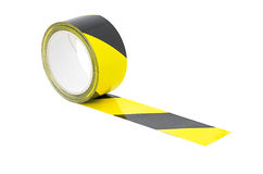A Roll of yellow and black caution tape Royalty Free Stock Images