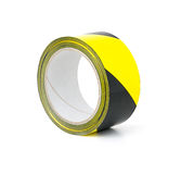 Roll of yellow and black caution tape. Roll of yellow and black warning tape Stock Photography