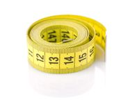 Roll of yellow tapeline Royalty Free Stock Image
