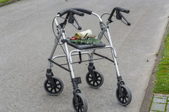 Rollator walker with grave candle Royalty Free Stock Images