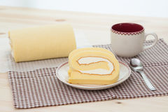 Rollcake with coffee cup. Rollcake with hot coffee cup Royalty Free Stock Images