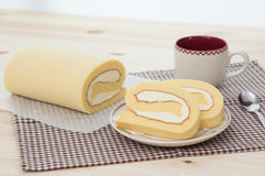 Rollcake with coffee cup. Rollcake with hot coffee cup Stock Photos