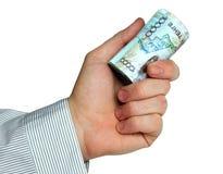 Rolle des Kazakhgeldes in der Hand Stockbilder
