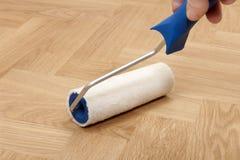 Rolle für Fußbodenlack Stockbilder