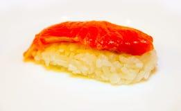 Rolle mit roten Fischen Stockbild