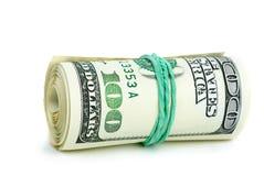 Rolle von $100 Banknoten zog mit Gummiband fest Stockfotografie
