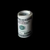 Rolle von den Dollar lokalisiert auf schwarzem Hintergrund Stockbilder