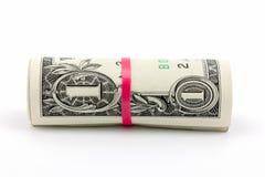 Rolle von einen Dollar Banknote auf weißem Hintergrund lizenzfreie stockfotografie