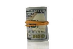 Rolle von hundert Dollarscheinen Stockbild
