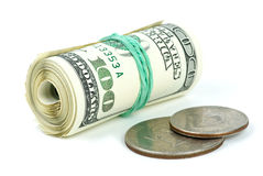 Rolled $100 bills and  coins Royalty Free Stock Photography