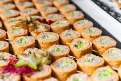 Rolled appetizers with fish paste stock photo