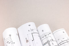 Rolled architectural blueprints and construction plans Royalty Free Stock Image