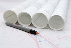 Free Rolled Architectural Plans And Drawing Utensils Royalty Free Stock Photos - 132225728