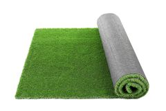 Rolled artificial grass carpet on white background. Exterior element royalty free stock photos