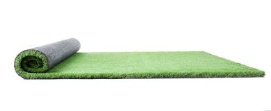 Rolled artificial grass carpet on white background. Exterior element royalty free stock images