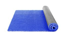 Rolled artificial grass carpet on white background. Exterior element stock photography