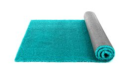 Rolled artificial grass carpet on white background. Exterior element royalty free stock image