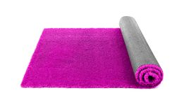 Rolled artificial grass carpet on white background. Exterior element stock photos