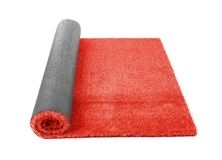 Rolled artificial grass carpet on white background. Exterior element stock image