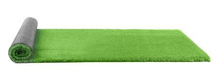 Rolled artificial grass carpet on white background. Exterior element stock photo
