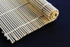 Rolled bamboo mat maki stock photography
