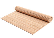 Rolled bamboo mat on white Royalty Free Stock Photography