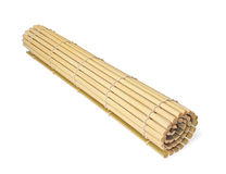 Rolled bamboo mat on white background. Isolated royalty free stock photo