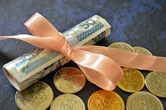 Rolled banknotes Stock Images