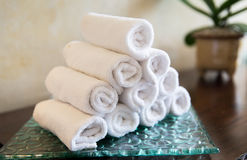 Rolled bath towels at hotel spa Stock Images