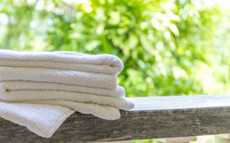 Rolled beach towels on natural green background. Rolled beach or spa towels on natural green background Royalty Free Stock Images