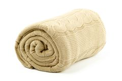 Rolled beige blanket Stock Photo
