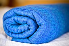 Rolled blue baby sling. Closeup of rolled blue baby sling Stock Image
